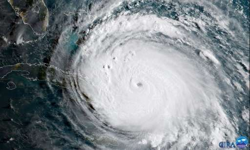 Economists say Hurricanes Harvey and Irma (seen from a NOAA satellite image), which caused tens of billions in damages and shutt