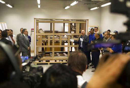 Egypt moves bed, chariot of King Tut to new museum