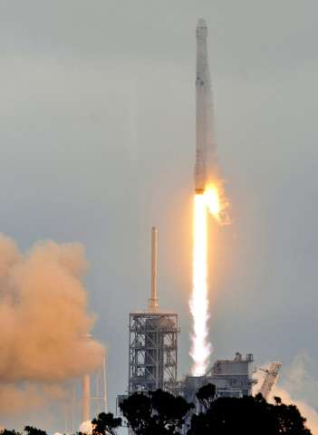 Elon Musk's SpaceX venture carries cargo to the International Space Station and has plans to send two private passengers on a tr