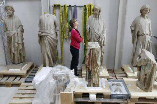 "Experts are also trying to crack the puzzle about how the much-damaged, repaired and repainted statues, "" the apostles of S"