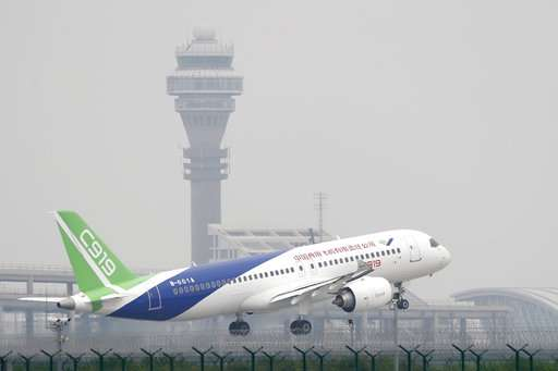 First large Chinese-made passenger jet makes its maiden flight