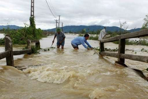 Floods and landslides in central and northern Vietnam have killed at least 37 people, with dozens more missing
