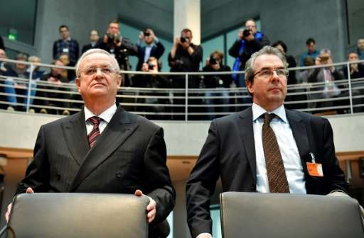 Former Volkswagen boss Martin Winterkorn (L) and VW manager Gerwin Postel pictured before taking their seats inside the Bundesta