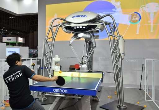 FORPHEUS, a fourth-generation table-tennis robot developed by automation parts maker Omron returns a shot to a human player at a