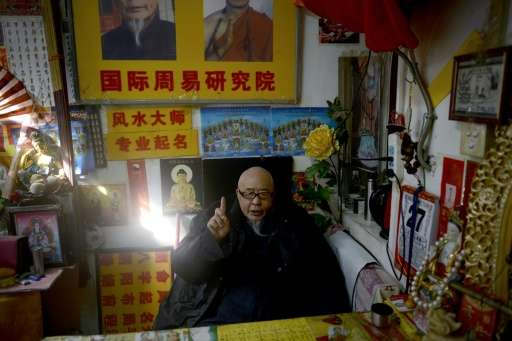Fortune teller Mao Shandong waits for customers at his shop in Beijing. Chinese have for centuries believed that a well-chosen n