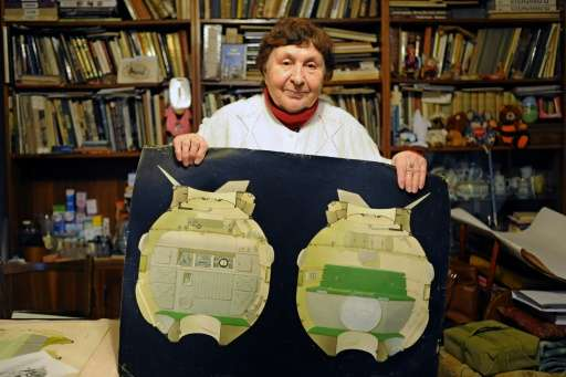 Galina Balashova, the artist who designed the first space habitation module for Soviet cosmonauts, shows drawings of her work in