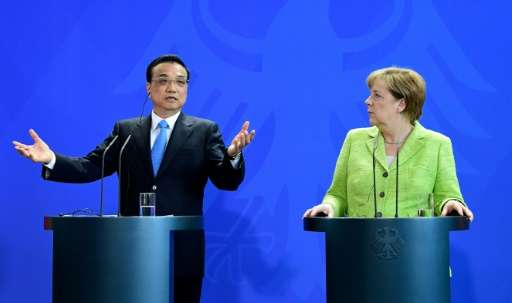 German Chancellor Angela Merkel and Chinese Prime Minister Li Keqiang give a joint press conference in Berlin on June 1, 2017