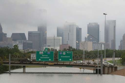 Highways leading into downtown Houston are submerged