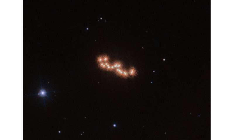 Hubble applauds waltzing dwarfs