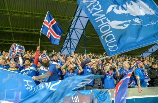 Icelandic football fans cheer their team during the FIFA World Cup 2018 qualification football match between Iceland and Ukraine