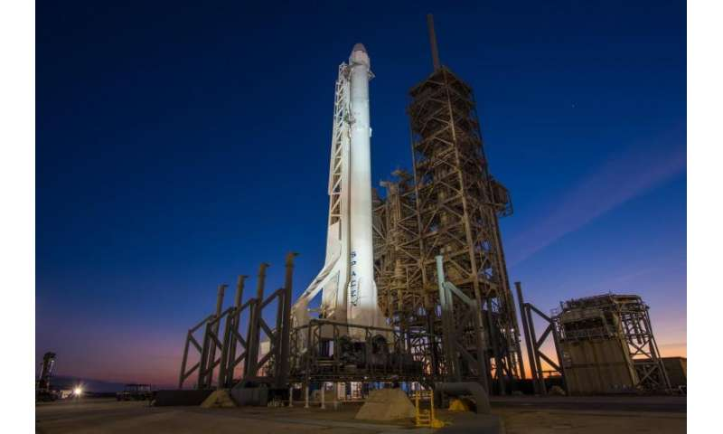 Image: Falcon 9 rocket with Dragon spacecraft vertical at Launch Complex 39A
