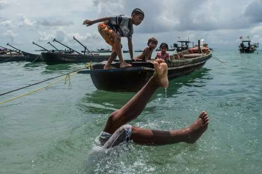 Impoverished, stateless and with restricted working rights, some Moken began diving for fishing crews in the early 90s and conti