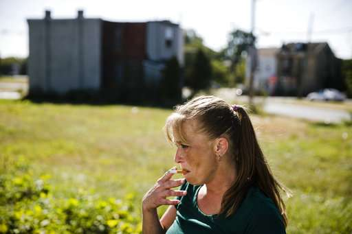 In a city ravaged by heroin, a needle exchange stalls