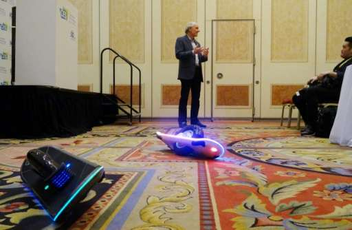 Inventor and CEO of Hoverboard Technologies, Robert Bigler unveils his GeoBlade transporter at the Consumer Electronics Show on