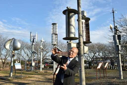 Izumi Ushiyama, a professor and expert of wind power at Ashikaga Institute of Technology, speaks at the natural energy square in