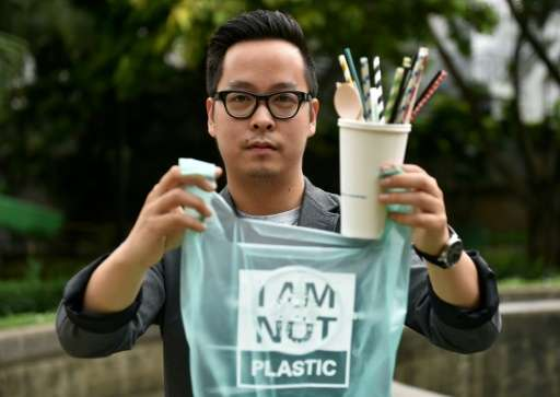 Kevin Kumala, founder of Avani Eco, shows his products during an interview in Jakarta