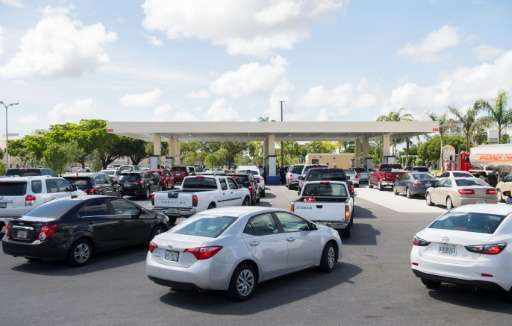Lines of cars snaked around those gas stations that remained open in Miami, as Florida prepared for Hurricane Irma