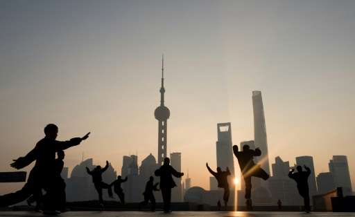 Morning exercises in front of the Lujiazui financial district in Shanghai