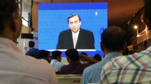 Mukesh Ambani told Reliance shareholders at their annual general meeting the free JioPhone would be available in September. Amba