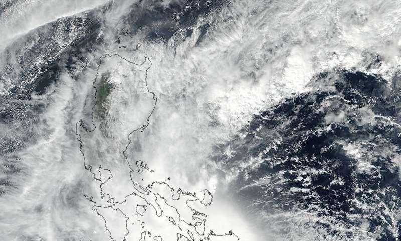 NASA follows a fading Kai-Tak into the South China Sea