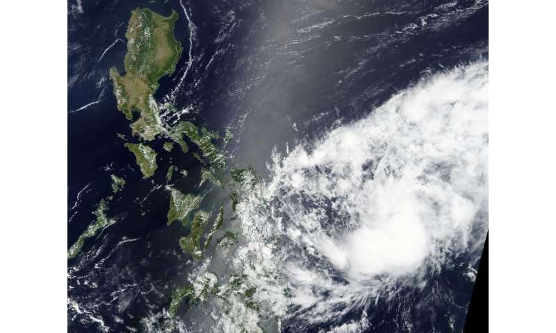 NASA sees central and south Philippines bracing for Tropical Depression 02W