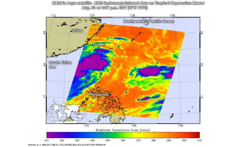 NASA sees large Tropical Depression Mawar develop