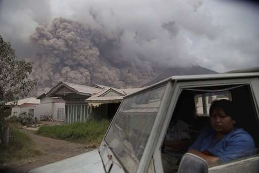 New eruption at Indonesia volcano spreads ash for miles