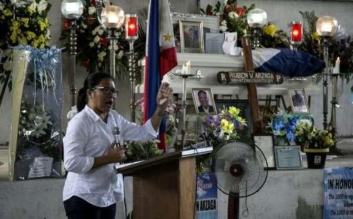Nieves Rosento, mayor of the town of El Nido, Palawan island, the Philippines, speaks at the wake of murdered environmental para