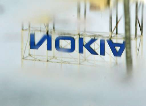 Nokia reports loss, warns of decline in networks industry