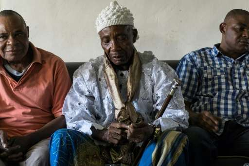 Obung community village leader Chief Ntufam Igne (C) speaks during an interview with the AFP, in Calabar, Nigeria