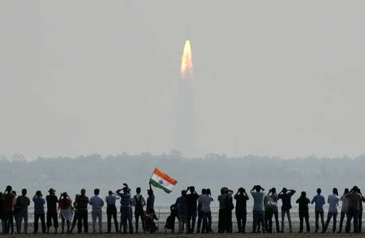 Onlookers watch the launch of the Indian Space Research Organisation (ISRO) Polar Satellite Launch Vehicle (PSLV-C37) at Srihari