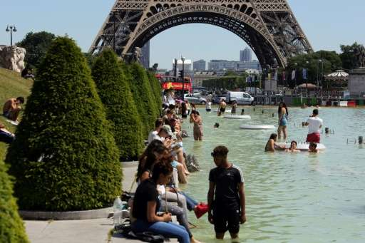 People refresh themselves in the Trocadero fountain in Paris, on June 19, 2017, as the French capital is placed on heatwave aler