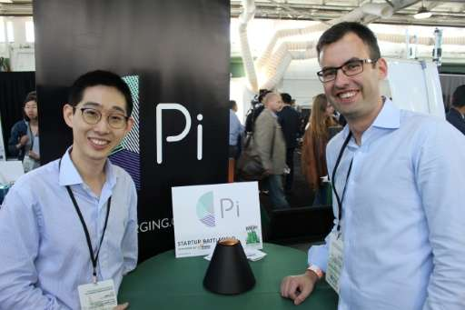 Pi co-founders Lixin Shi, left, and John MacDonald tout their invention as the world's first wireless charger that does away wit