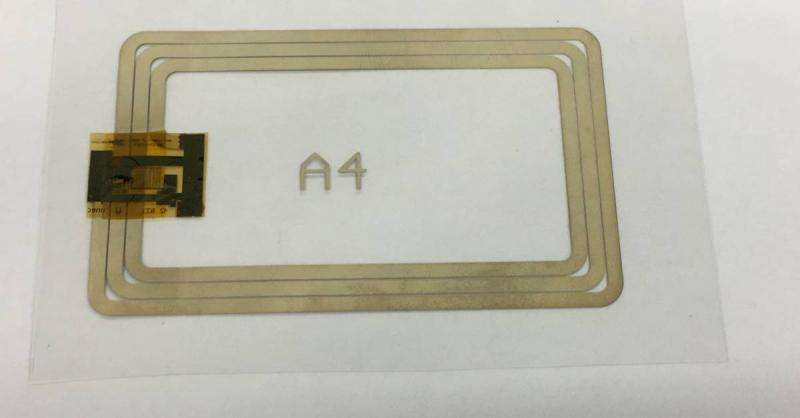 Plastic 12-bit RFID tag and read-out system with screen-printed antenna