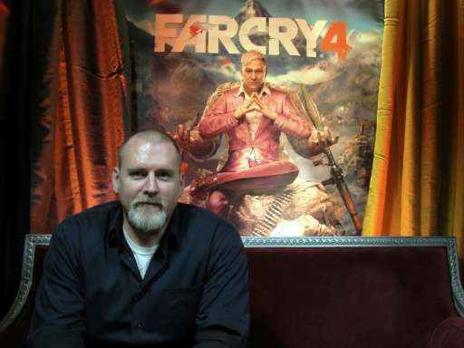 """Far Cry 4"" video game executive director Dan Hay pictured in front of a poster for the Ubisoft title in San Francisco"