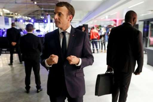 """""""Without much stronger mobilisation, a jolt to our means of production and development, we will not succeed,"""" Macron w"""