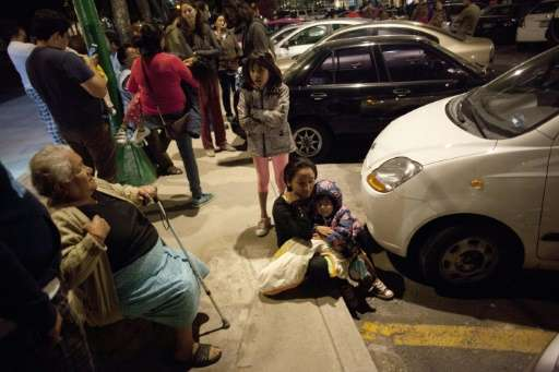 Residents gather on a street in Mexico City on September 7, 2017, after an earthquake of magnitude 8.1, according to the US Geol