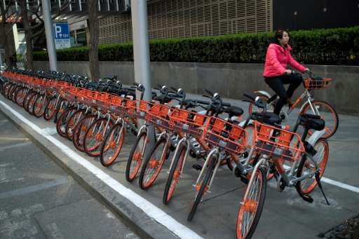 Soaring numbers of cyclists are causing problems in China's cities because many simply leave the bikes in the middle of sidewalk