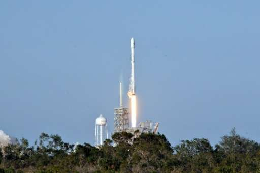 "Space X's recycled Falcon 9 rocket lifts off from Kennedy Space Center, cheered by experts as a ""historic"" moment as c"