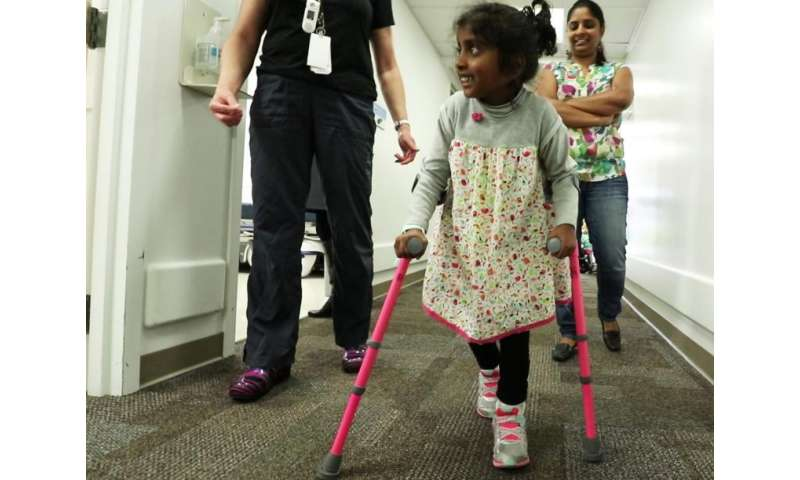 Spine surgery helps girl with cerebral palsy walk