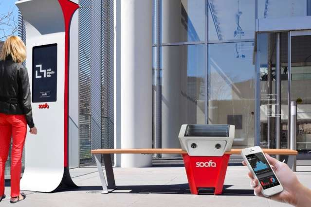 Startup brings solar-powered, phone-charging park benches and digital signs to cities worldwide