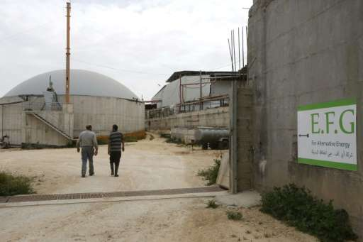 Storage silos at Jebrini dairy farm in the West Bank town of Hebron, where cow dung is used to produce electricity as an alterna
