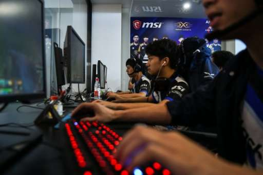 Taiwanese gamers from the eSports team Flash Wolves play during training for the League of Legends World Championship, at a boot