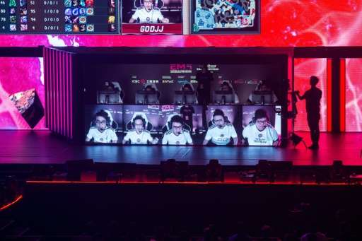 Team Hong Kong, Taiwan and Macau (C) play on stage in the League of Legends gaming tournament during the eSports and Music Festi