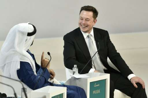 Tesla CEO Elon Musk (right) with Mohammad al-Gergawi, UAE Minister of Cabinet Affairs and Future, at the World Government Summit