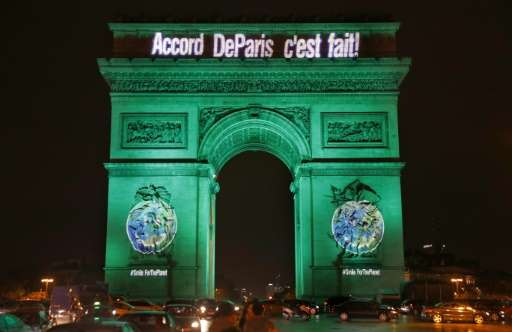 "The Arc de Triomphe is illuminated with the lettering reading ""The Paris accord is done"" in Paris on November 4, 2016,"