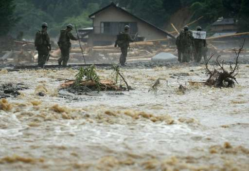 The death toll from heavy rains and flooding in southern Japan has risen to 18