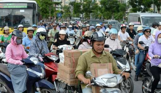 There are five million motorbikes among a population of about seven million in Hanoi, compared to half a million cars on the roa