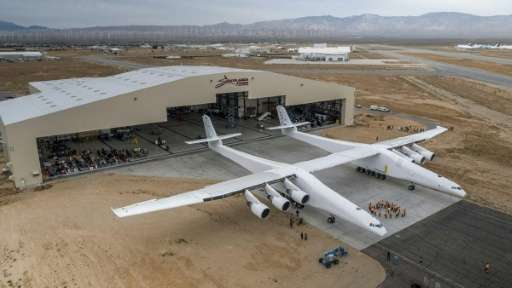 The Stratolaunch plane is pushed out of the hanger for the first time in the Mojave desert, California on May 31, 2017