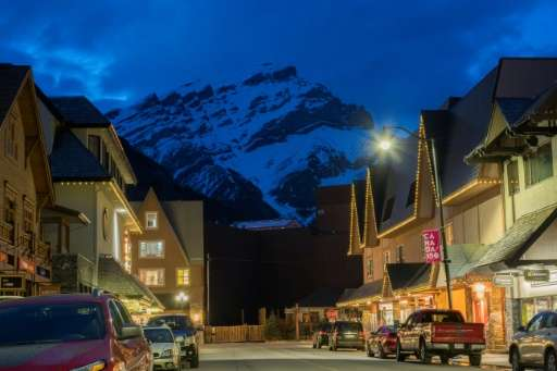 The town of Banff at dusk. Conservationists fear rapidly increasing numbers of visitors could be a risk for Canada's national pa